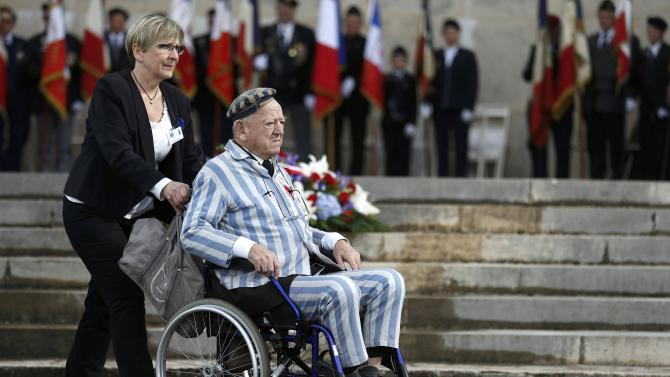 Holocaust survivor Robert Salomon is pushed in a wheelchair at the former World War II concentration camp of Natzweiler-Struthof during ceremonies to mark the French National Deportation Day, in Natzweiler,