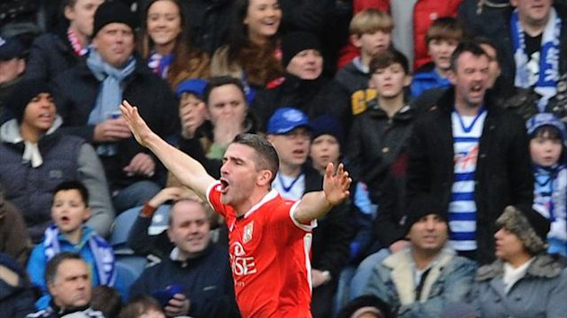 Ryan Lowe celebrates scoring MK Dons' second goal against QPR