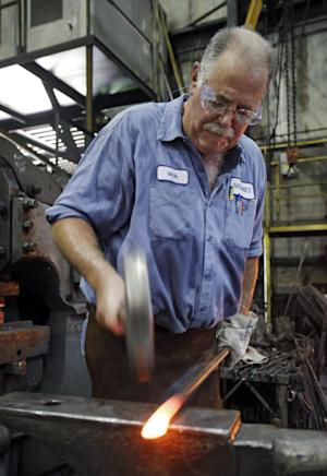 In this Thursday, Sept. 6, 2012, photo, Bob Kurz shapes a pry bar at Solmet Technologies in Canton, Ohio. U.S. manufacturing grew for the first time in four months, buoyed by a jump in new orders in September.  The increase was a hopeful sign that the economy is improving. The Institute for Supply Management, a trade group of purchasing managers, said Monday, Oct. 1, 2012, that its index of factory activity rose to 51.5. That's up from 49.6 in August. (AP Photo/Mark Duncan)