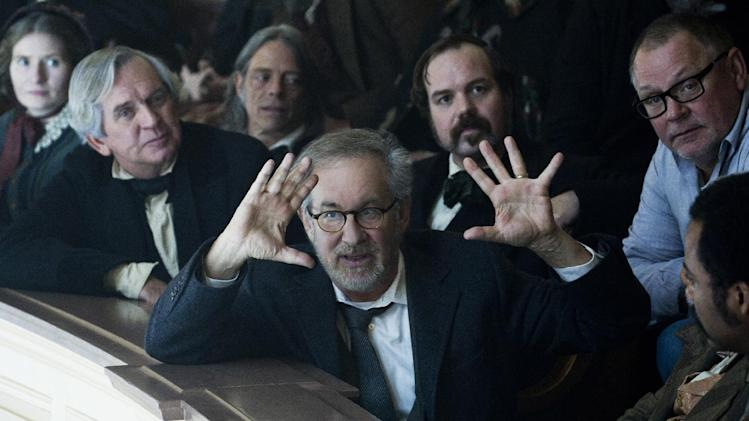 "In this publicity photo released by DreamWorks and Twentieth Century Fox, Director/Producer Steven Spielberg sets up a shot in The House of Representatives while Director of Photography, Janusz Kaminski, far right, looks on during the production of the film, ""Lincoln,"" from DreamWorks Pictures and Twentieth Century Fox. (AP Photo/DreamWorks, Twentieth Century Fox, David James)"