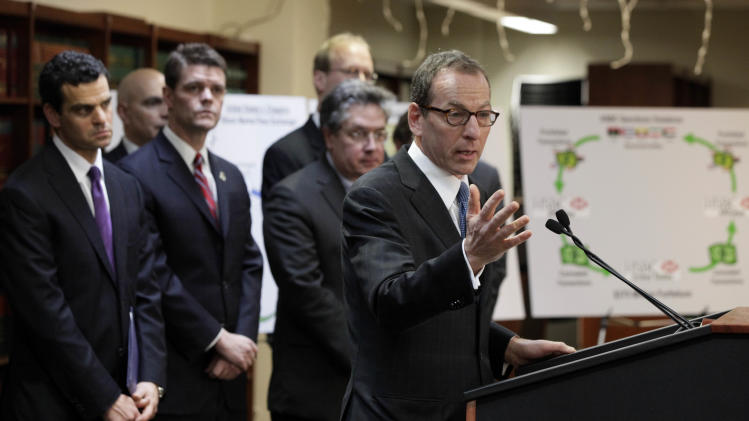 Lanny Breuer, right, Assistant Attorney General  of the Justice Department's Criminal Division, addresses a news conference in Brooklyn, N.Y., Tuesday, Dec. 11, 2012. British bank HSBC has agreed to pay $1.9 billion to settle a New York based-probe in connection with the laundering of money from narcotics traffickers in Mexico, U.S. authorities announced Tuesday. Joining Breuer are, from left, Treasury Under Secretary David Cohen; Director of U.S. Immigration and Customs Enforcement John Morton; and Comptroller of the Currency Thomas Curry.  (AP Photo/Richard Drew)