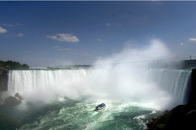 The Maid of the Mist enters near the dangers zone before Nik Wallenda's attempt to walk a 1,800-foot (550-meter) long tightrope over the brink of the Niagara Falls in Niagara Falls, Ont., on Friday, J