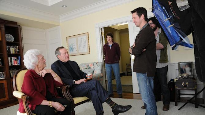 """This image released by HBO shows former first lady Barbara Bush, from left, former President George H. W. Bush, Kris Conde, Stephen Glidden, Jeffrey Roth during the filming of """"41,"""" a documentary about Bush premiering Thursday, June 14, at 9:00 p.m. EST on HBO. (AP Photo/HBO, Brian Blake)"""