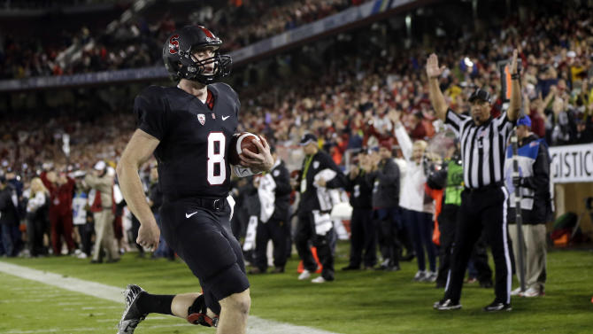 Stanford quarterback Kevin Hogan scores on a 2-yard run against UCLA during the first half of the Pac-12 championship NCAA college football game in Stanford, Calif., Friday, Nov. 30, 2012. (AP Photo/Marcio Jose Sanchez)