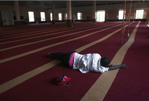 South Sudanese man sleeps inside a mosque at Konyokonyo area of the capital Juba