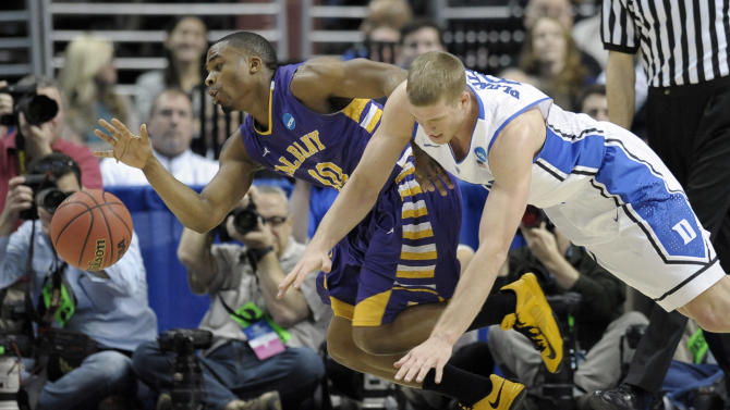 Albany's Mike Black, left, and Duke's Mason Plumlee chase after a loose ball during the first half of a second-round game of the NCAA college basketball tournament, Friday, March 22, 2013, in Philadelphia. (AP Photo/Michael Perez)