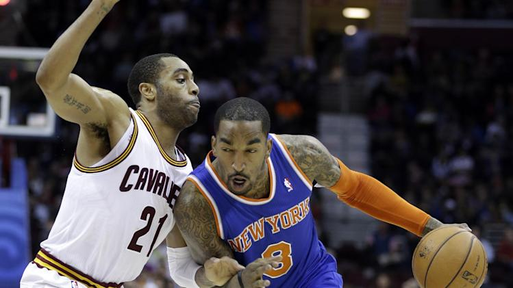 New York Knicks' J.R. Smith (8) drives past Cleveland Cavaliers' Wayne Ellington (21) in the third quarter of an NBA basketball game on Friday, April 12, 2013, in Cleveland. Smith scored 31 points in the Knicks' 101-91 win. (AP Photo/Mark Duncan)