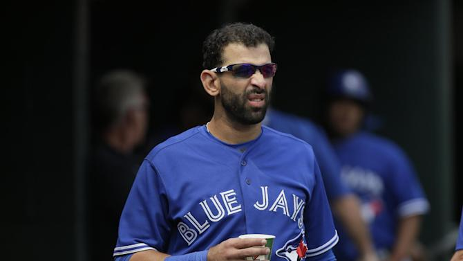 Toronto Blue Jays' Jose Bautista watches from the dugout during a game against the Detroit Tigers of a baseball game Sunday, July 5, 2015, in Detroit. (AP Photo/Duane Burleson)