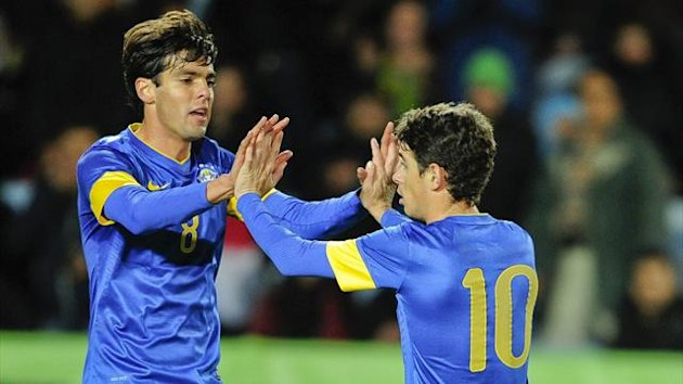 Brazil's Kaka (L) celebrates with Oscar after Oscar's goal in their international friendly soccer match against Iraq at Swedbank Stadion (Reuters)