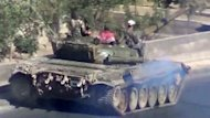 "A video uploaded on YouTube shows Syrian troops riding a tank on their way to Daraya on the outskirts of the capital Damascus. Syrian President Bashar al-Assad says the foreign ""conspiracy"" against his country will be defeated, as his forces were accused of a bloody rampage that left hundreds dead"