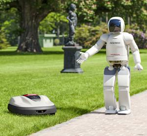 In this undated photo released by Honda Motor Co., its Asimo walking talking robot shows its new product lawn mower Milmo. Honda finally has its first product for the home packed with its prized robotics technology — a sensor-equipped lawn mower. Miimo goes on sale next year, selling for 2,100 euros ($2,600) to 2,500 euros ($3,000), in only Europe. The machine, which looks a bit like iRobot Corp.'s Roomba vacuum cleaner, continuously shaves about 3 millimeters (0.12 inches) off the grass, maneuvering itself on slopes. (AP Photo/Honda Motor Co.) EDITORIAL USE ONLY