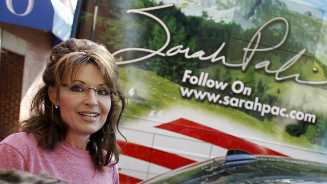 "FILE - In this June 2, 2011 file photo, former Alaska Gov. Sarah Palin stands near her tour bus outside a hotel in Boston. The Republican primary campaign is already fading into memory. Remember Herman Cain's 9-9-9 tax plan? Newt Gingrich's ""moon base"" proposal? Or Rick Perry's ""oops"" moment _ when he couldn't recall that third federal agency he wanted to eliminate? (AP Photo/Steven Senne, File)"