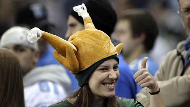 Green Bay Packers fan Jackie Shillington, of Boston, gives a thumbs-up during the NFL football game between the Detroit Lions and Green Bay Packers in Detroit, Thursday, Nov. 24, 2011. (AP Photo/Paul Sancya)