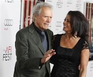 "Director Clint Eastwood and his wife Dina arrive at the opening night gala for AFI Fest 2011 with the premiere of Eastwood's film ""J. Edgar"" in Hollywood November 3, 2011. REUTERS/Fred Prouser/Files"