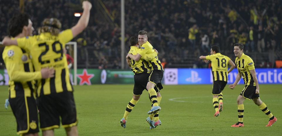 Dortmund's players celebrate their victory team's victory at the end of the Champions League quarterfinal second leg soccer match between Borussia Dortmund and Malaga CF in Dortmund, Germany, Tuesday, April 9, 2013. (AP Photo/Martin Meissner)