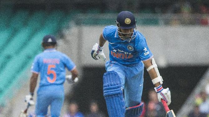 Indian Ajinkya Rahane runs through for a quick single during their one day international cricket match in Sydney, Monday, Jan. 26, 2015. (AP Photo/Milos Lekovic)