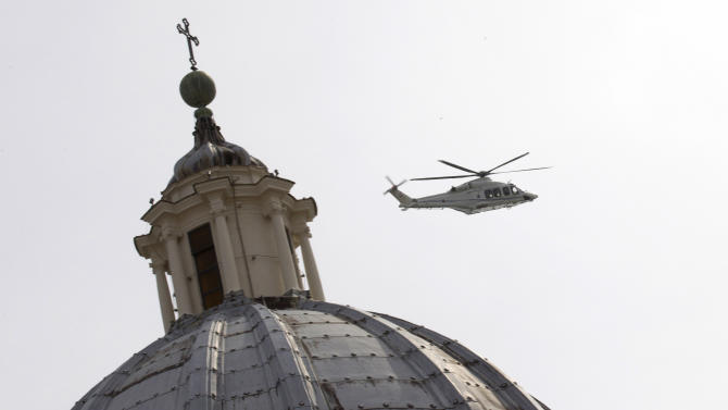 """The helicopter carrying Pope Francis flies over Castel Gandolfo, Saturday March 23, 2013. Pope Francis traveled Saturday to this hilltown south of Rome to have lunch with his """"brother"""" and predecessor Benedict XVI, an historic and potentially problematic melding of the papacies that has never before confronted the Catholic Church. The two men in white embraced warmly on the helipad in the gardens of Castel Gandolfo, where Benedict has been living since he retired Feb. 28 and became the first pope to resign in 600 years. (AP Photo/Alessandra Tarantino)"""