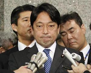 Japan's Defence Minister Onodera speaks to reporters at the Defence Ministry in Tokyo