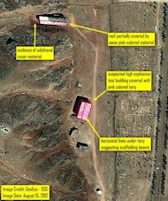 An August 15 satellite image shows &quot;the suspected high explosives test building covered with a tent like material most likely supported by scaffolding&quot; at the Parchin site in Iran. Iran on Friday rejected allegations in a new International Atomic Energy Agency report that it was frustrating UN inspection of Parchin, a suspected nuclear weapons research facility, by apparently scrubbing it clean