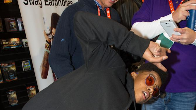 """Hip hop artist, """"Lil Twist"""" seen at International CES 2013, on Thursday, January 10, 2013 in Las Vegas, NV for the debut of his new headphone collection """"Twist Swag Headphones by Nikura USA (Photo by Al Powers of Powers Imagery/Invision for Nikura USA/AP Images)"""