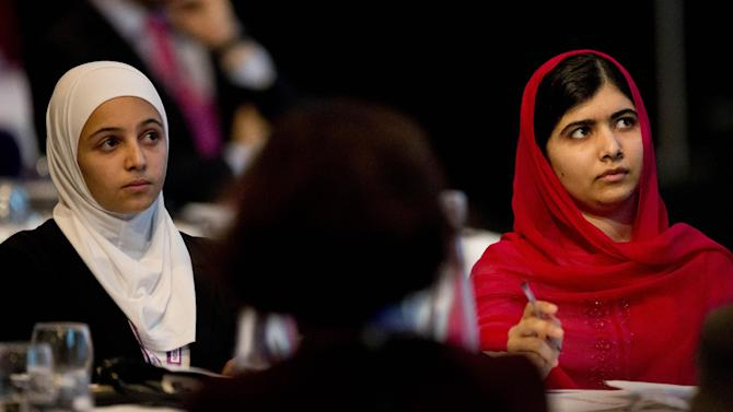 Nobel Peace Prize winner Malala Yousafzai, right, from Pakistan and 17-year-old Syrian refugee Mazoun Almellehan, left, listen to other speakers during the first focus event on education at the 'Supporting Syria and the Region' conference at the Queen Elizabeth II Conference Centre in London, Thursday, Feb. 4, 2016.  Leaders and diplomats from 70 countries are meeting in London Thursday to pledge billions to help millions of Syrians displaced by war, and try to slow the chaotic exodus of refugees to Europe. (AP Photo/Matt Dunham, Pool)