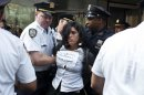 An Occupy Wall Street activist is arrested while protesting in the streets of New York's Financial District on the one-year anniversary of the movement, in New York