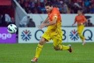 Barcelona's forward Lionel Messi runs with the ball during a friendly match against Paris Saint-Germain at the Parc des Princes stadium in Paris. Barcelona won 4-1 on penalties