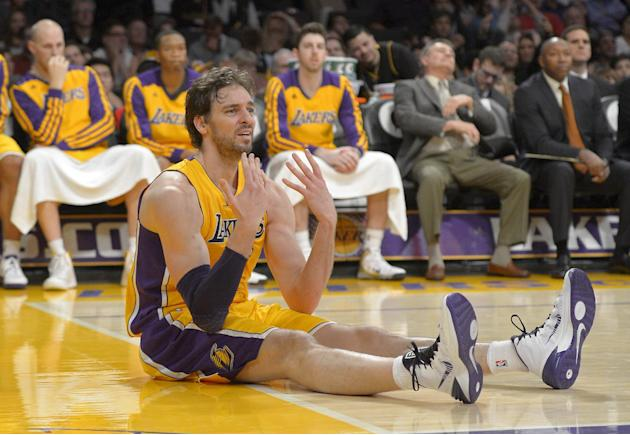 Los Angeles Lakers center Pau Gasol, of Spain, reacts after passing the ball to the wrong team from the floor during the second half of an NBA basketball game against the Cleveland Cavaliers, Tuesday,