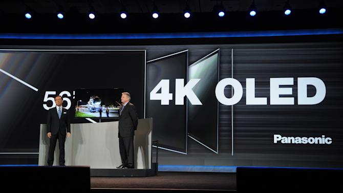 """(Left to right) CEO of Panasonic, Kazuhiro Tsuga, and CEO of Panasonic North  America, Joe Taylor, introduce the new 56"""" 4k OLED Television seen at the International Consumer Electronics Show 2013, on Tuesday, January 8, 2013, Las Vegas, NV during the Panasonic Keynote presentation (Photo by Al Powers/Invision for Panasonic/AP Images)"""