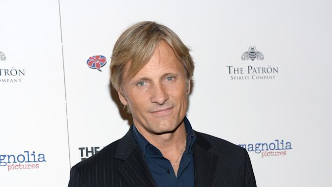 """Viggo Mortensen arrives at the New York premiere of """"The Two Faces of January"""" at the Sunshine Landmark on Wednesday, Sept. 17, 2014. (Photo by Evan Agostini/Invision /AP)"""