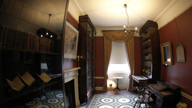 "The study in Charles Dickens' home, part of the Charles Dickens Museum in London, Wednesday, Dec. 5, 2012. For years, the four-story brick row house where the author lived with his young family was a dusty and slightly neglected museum, a mecca for Dickens scholars but overlooked by most visitors to London. Now, after a 3 million pound ($4.8 million) makeover, it has been restored to bring the writer's world to life. Its director says it aims to look ""as if Dickens had just stepped out."" (AP Photo/Sang Tan)"