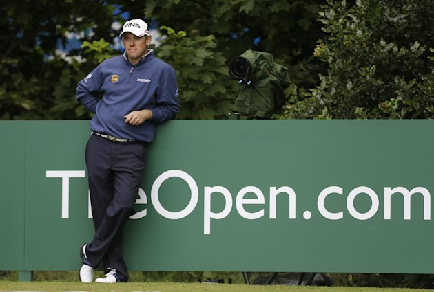 Lee Westwood of England waits to play a shot off the 1st tee during a practice round at Royal Lytham & St Annes golf club ahead of the British Open Golf Championship, Lytham St Annes, England Tuesday, July 17, 2012. (AP Photo/Jon Super)