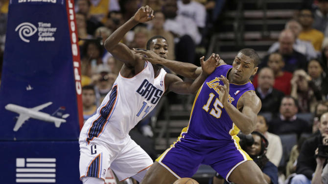 Los Angeles Lakers' Metta World Peace (15) and Charlotte Bobcats' Michael Kidd-Gilchrist (14) battle for a loose ball during the first half of an NBA basketball game in Charlotte, N.C., Friday, Feb. 8, 2013. (AP Photo/Chuck Burton)