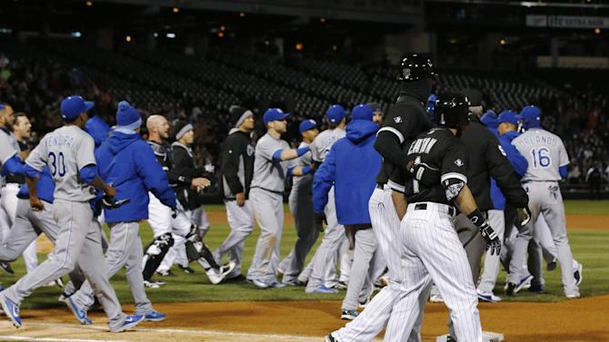 Chicago White Sox's Adam Eaton (1) is pulled aside by first base coach Daryl Boston as the benches clear during the seventh inning of the White Sox's baseball game against the Kansas City Royals on Thursday, April 23, 2015, in Chicago. The Royals won 3-2 in 13 innings. (AP Photo/Andrew A. Nelles)