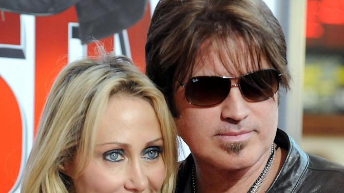 """FILE - In this Jan. 9, 2010 file photo, Billy Ray Cyrus, at right, and his wife Laeticia """"Tish"""" Cyrus, arrive to the premiere of """"The Spy Next Door"""" in Los Angeles. Court records show  Tish Cyrus filed for divorce on Thursday, June 13, 2013 in Los Angeles Superior Court. (AP Photo/Katy Winn, file)"""