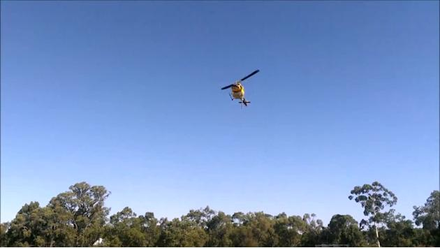 Firefighting Helicopters Land on Cricket Ground