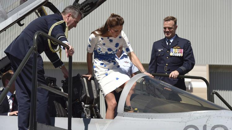 Catherine, the Duchess of Cambridge climbs into the cockpit of a RAAF Super Hornet of 1 Squadron at RAAF Base Amberley near Brisbane
