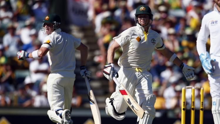 Australia's Smith and Haddin run between wickets during the first day of the third Ashes cricket test against England at the WACA ground in Perth