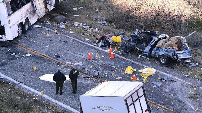 FILE - In this Feb. 4, 2013 photo, investigators work the scene where a tour bus collided with a pickup truck on Highway 38 north of Yucaipa, Calif., killing eight people. Federal regulators on Friday, Feb. 8, 2013 ordered the tour bus operator, National City, Calif.-based Scapadas Magicas LLC,  to immediately stop operating because its buses weren't properly maintained or inspected and its drivers weren't properly vetted for qualifications.  (AP Photo/The Sun, Rick Sforza, File)
