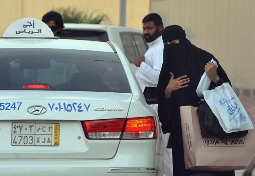 A Saudi woman gets into a taxi outside a shopping mall in Riyadh. Saudi female activists have cancelled their plan to brave a driving ban on Friday, settling instead for petitioning King Abdullah to allow them to get behind the wheel, members of their group said