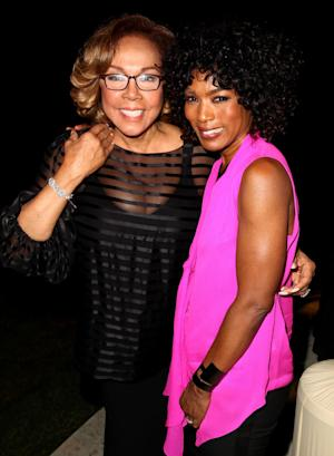 "Diahann Carol, left, and Angela Bassett pose together at the ""House of Flowers"" dinner honoring Carol and AMPAS President Cheryl Boone Isaacs at the home of Tracey Edmonds on Saturday, Oct. 19, 2013 in Beverly Hills, Calif. (Photo by Matt Sayles/Invision/AP)"