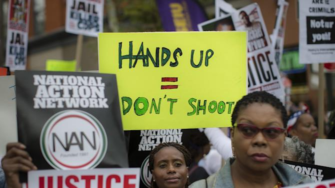 Demonstrators prepare to march as they protest the death of 43-year-old Eric Garner, Saturday, Aug. 23, 2014, in the Staten Island borough of New York. The city medical examiner ruled that Garner, 43, died as a result of a police chokehold during an attempted arrest. (AP Photo/John Minchillo)