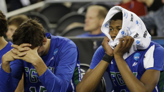 Florida Gulf Coast's Filip Cvjeticanin (15) and Eric McKnight (12) react during the final mintues of a regional semifinal game against Florida in the NCAA college basketball tournament, Saturday, March 30, 2013, in Arlington, Texas. (AP Photo/David J. Phillip)