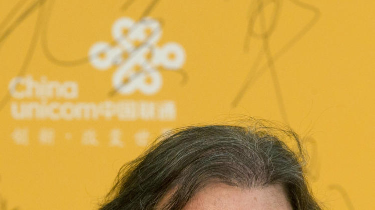 U.S director Oliver Stone arrives for the 4th Beijing International Film Festival held in Beijing, China, Wednesday, April 16, 2014. (AP Photo/Ng Han Guan)