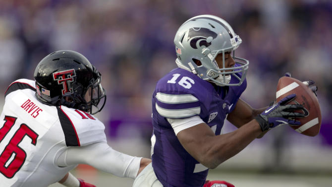 Kansas State wide receiver Tyler Lockett (16) catches a pass while covered by Texas Tech safety Cody Davis (16) during the second half of an NCAA college football game in Manhattan, Kan., Saturday, Oct. 27, 2012. (AP Photo/Orlin Wagner)