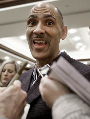"""FILE - In tihs Jan. 18, 2013, file photo, former NFL coach Tony Dungy, left, speaks to reporters at the NCAA convention in Grapevine, Texas. The Rooney Rule is broken and must be fixed. That's how former NFL coaches Tony Dungy, Herm Edwards and Jim Caldwell feel after seeing openings for eight head coaches and seven general managers this offseason not go to any minority candidates. Says Dungy: """"It's not working the way it should.""""   (AP Photo/LM Otero, File)"""