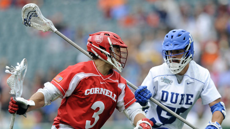 Cornell's Rob Pannell (3) drives past Duke's Bill Conners (55) during the first half of an NCAA division 1 semifinal lacrosse game on Saturday, May 25, 2013, in Philadelphia. (AP Photo/Michael Perez)