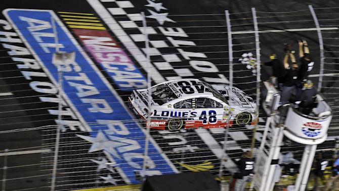 Jimmie Johnson (48) takes the checkered flag to win the NASCAR Sprint Cup Series All-Star auto race at Charlotte Motor Speedway in Concord, N.C., Saturday, May 18, 2013. (AP Photo/Gerry Broome)