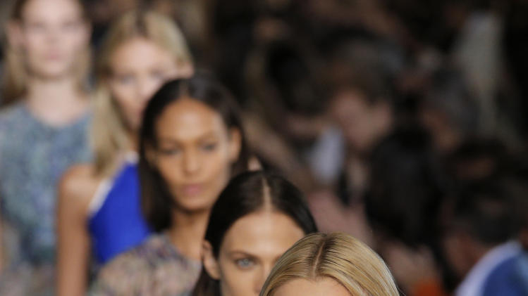 Models wear creations for British fashion designer Stella McCartney's ready to wear Spring-Summer 2013 collection, presented in Paris, Monday, Oct.1, 2012. (AP Photo/Francois Mori)