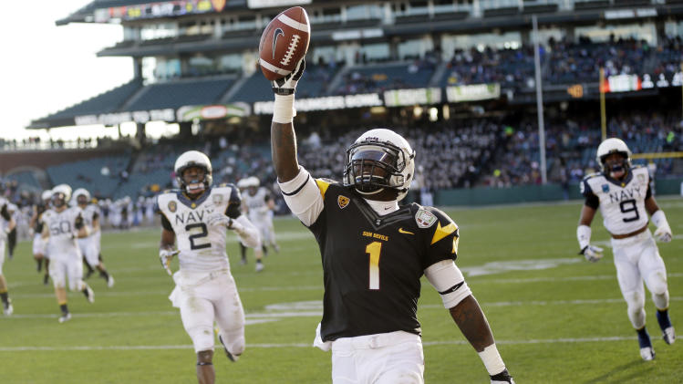 Arizona State running back Marion Grice (1) celebrates his 39-yard touchdown run against Navy during the second half of the Fight Hunger Bowl NCAA college football game in San Francisco, Saturday, Dec. 29, 2012. (AP Photo/Marcio Jose Sanchez)